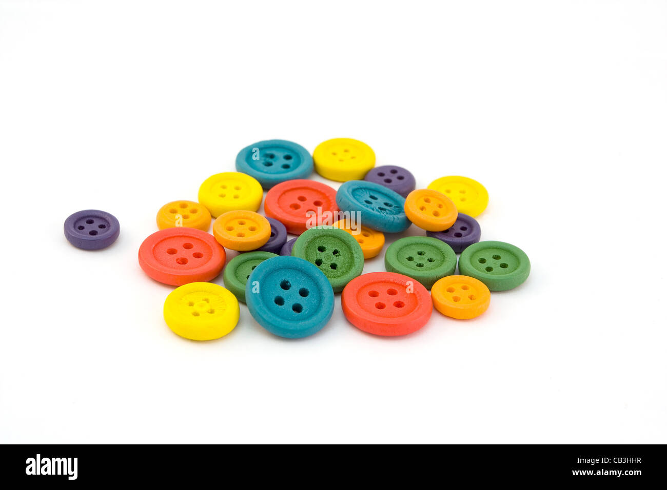 Pile of colorful buttons isolated on white - Stock Image