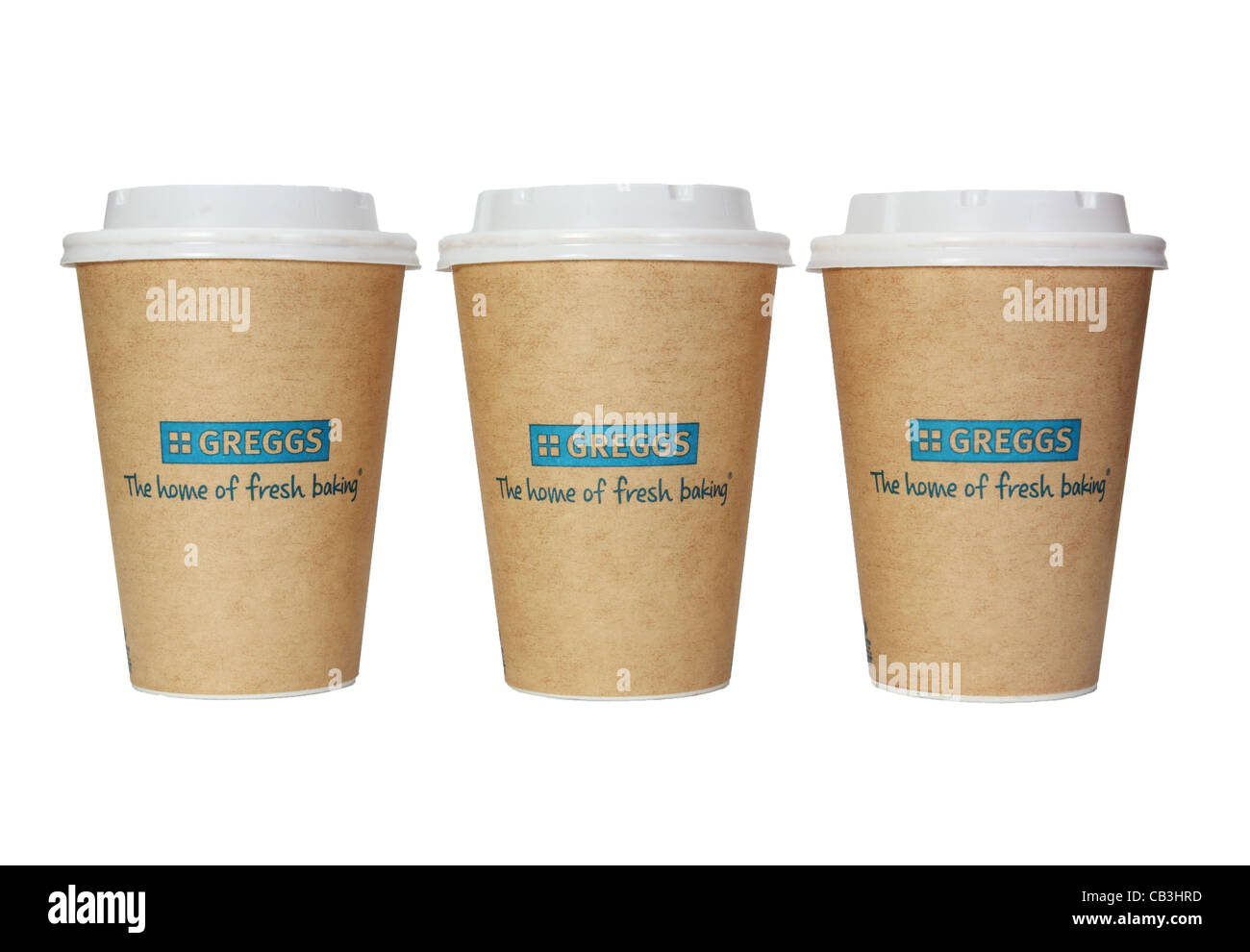 Greggs the bakers row of three paper cups or mugs or beakers with plastic lids, England UK  isolated on white background - Stock Image