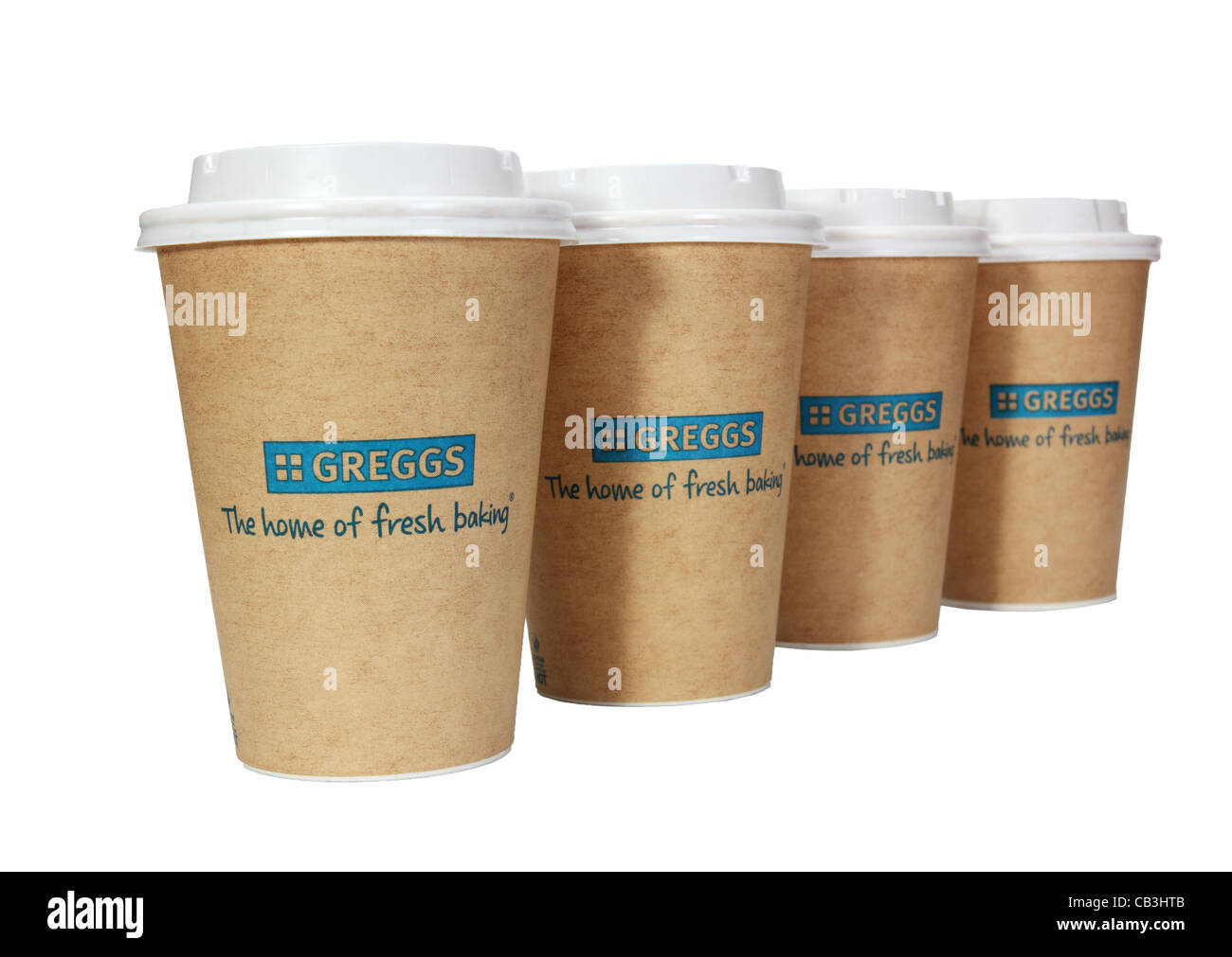 Greggs the bakers row of four  takeaway paper cups or mugs or beakers with plastic lids, England UK  isolated  white Stock Photo