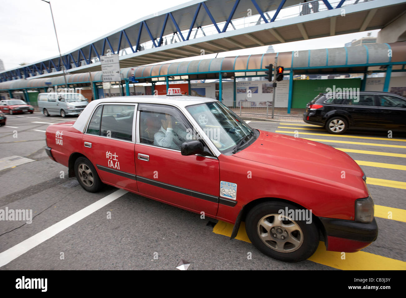 hong kong red taxi hong kong island hksar china motion blur Stock Photo