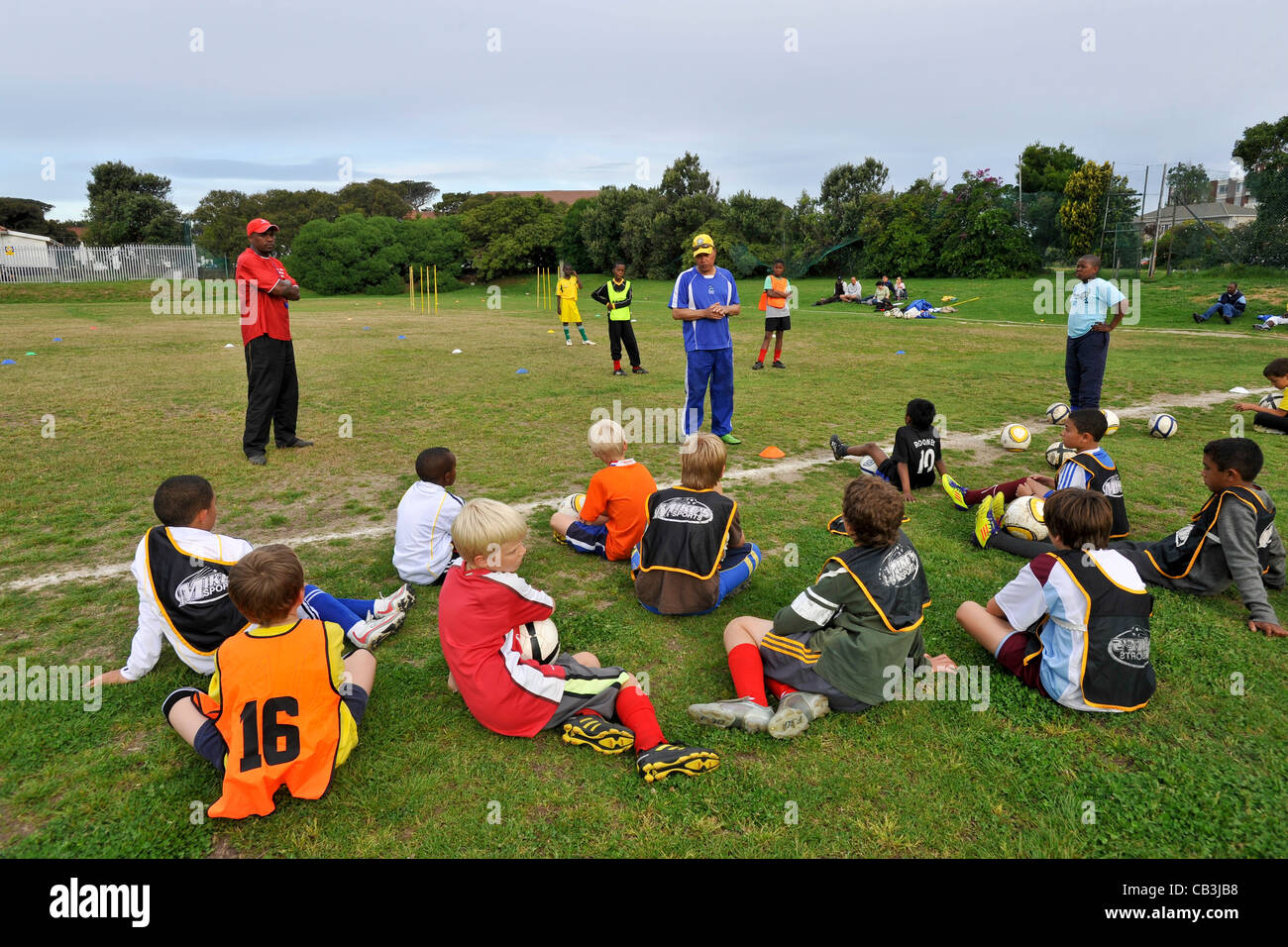 Football youth team players get instructions for their coach Cape Town South Africa - Stock Image