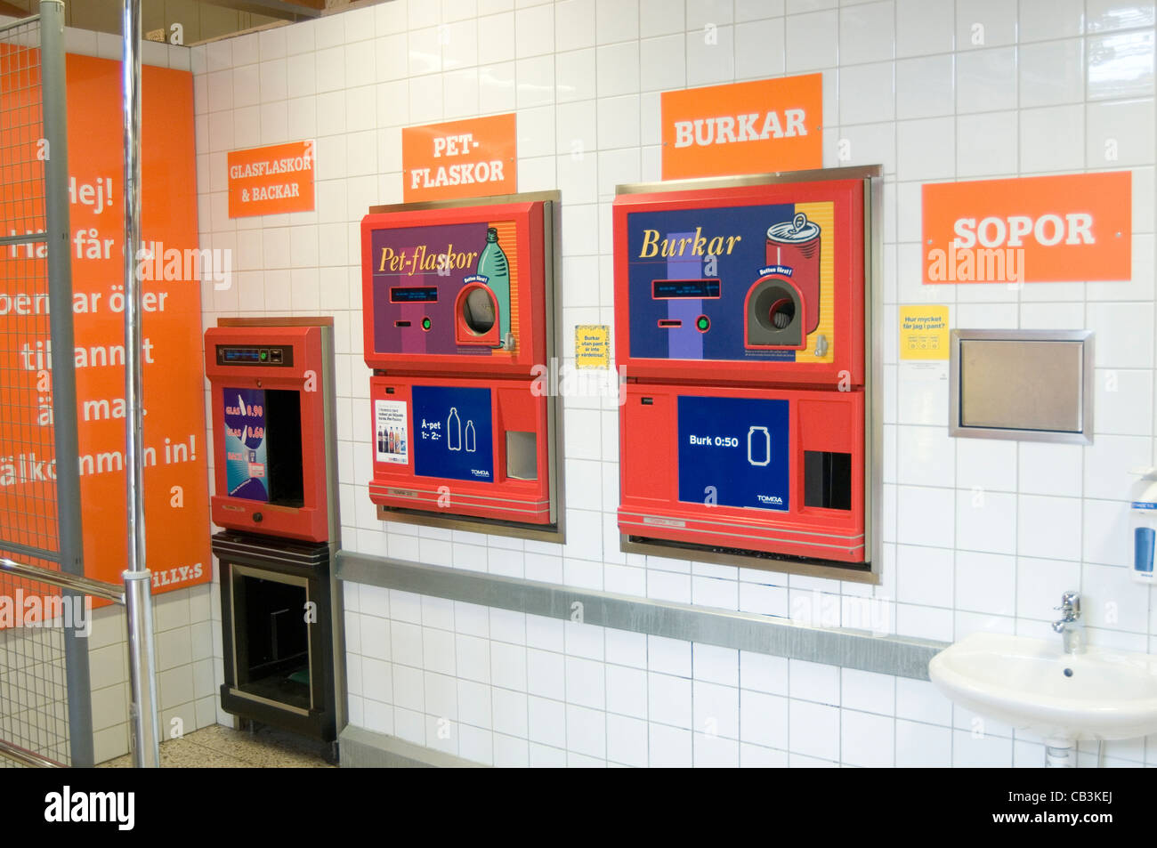 recycling station in swedish supermarket center sweden recycle cans can tins tin bottles bottle credit pant - Stock Image