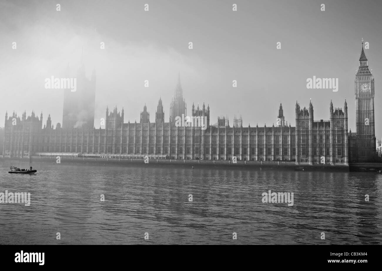 Black and white image of a foggy morning on the River Thames in London - Stock Image