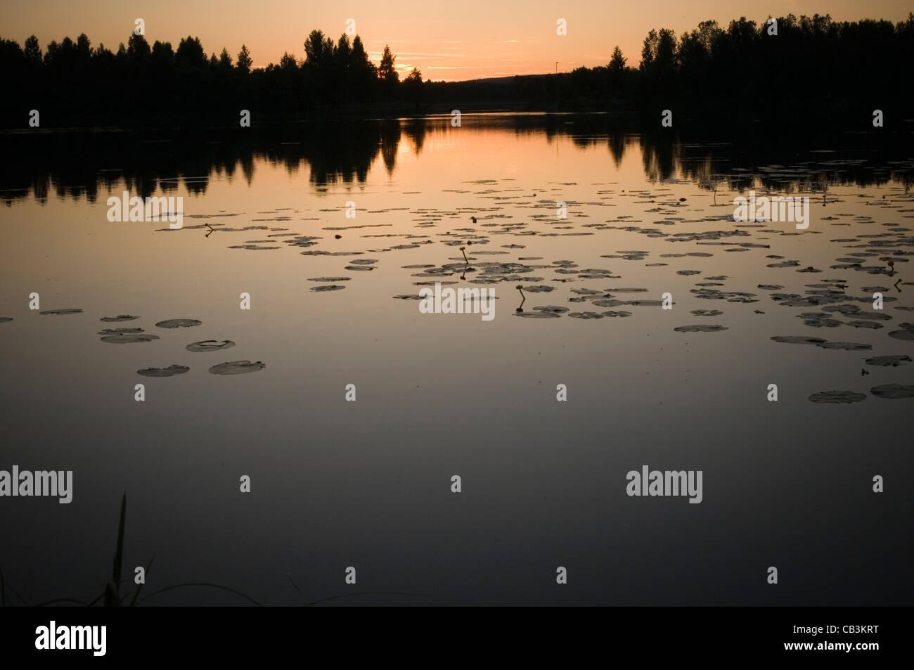 swedish lake lake sweden sunset still water waters sun set sets sunsets - Stock Image