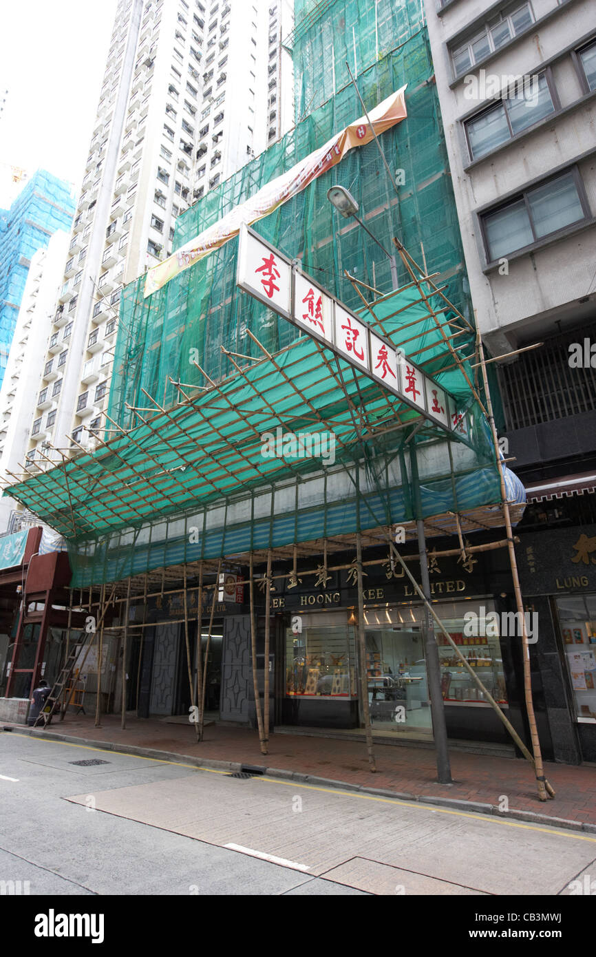 bamboo scaffolding on a building in hong kong island hksar china Stock Photo