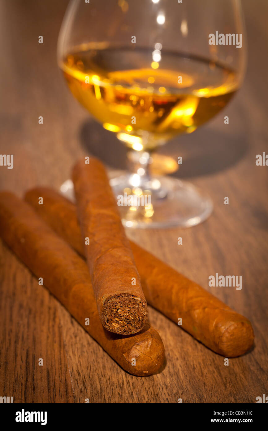 typical havana cigars with pure whisky drink background - Stock Image