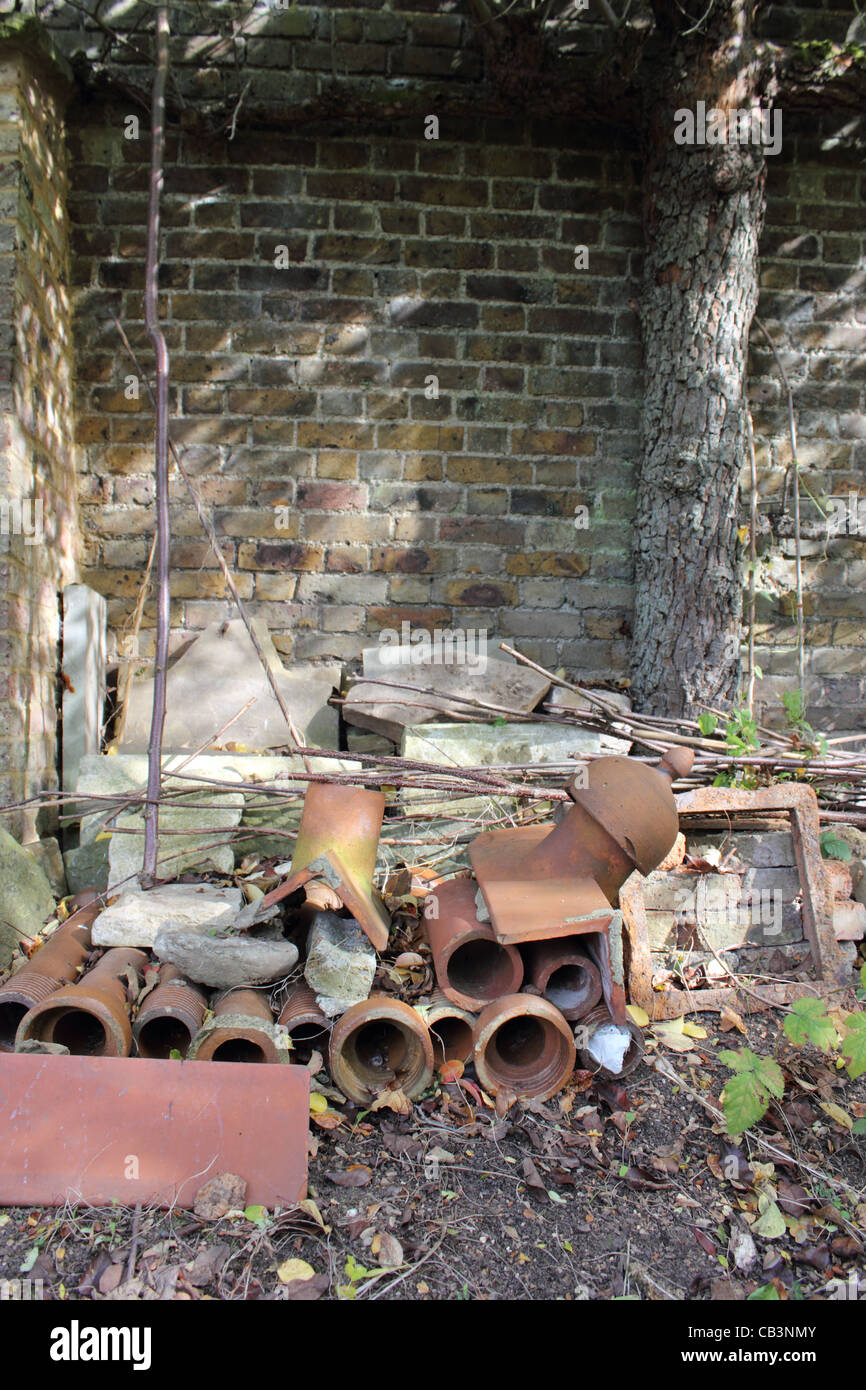 Terracotta Drainage Pipes And Masonry Against Vintage Garden ...
