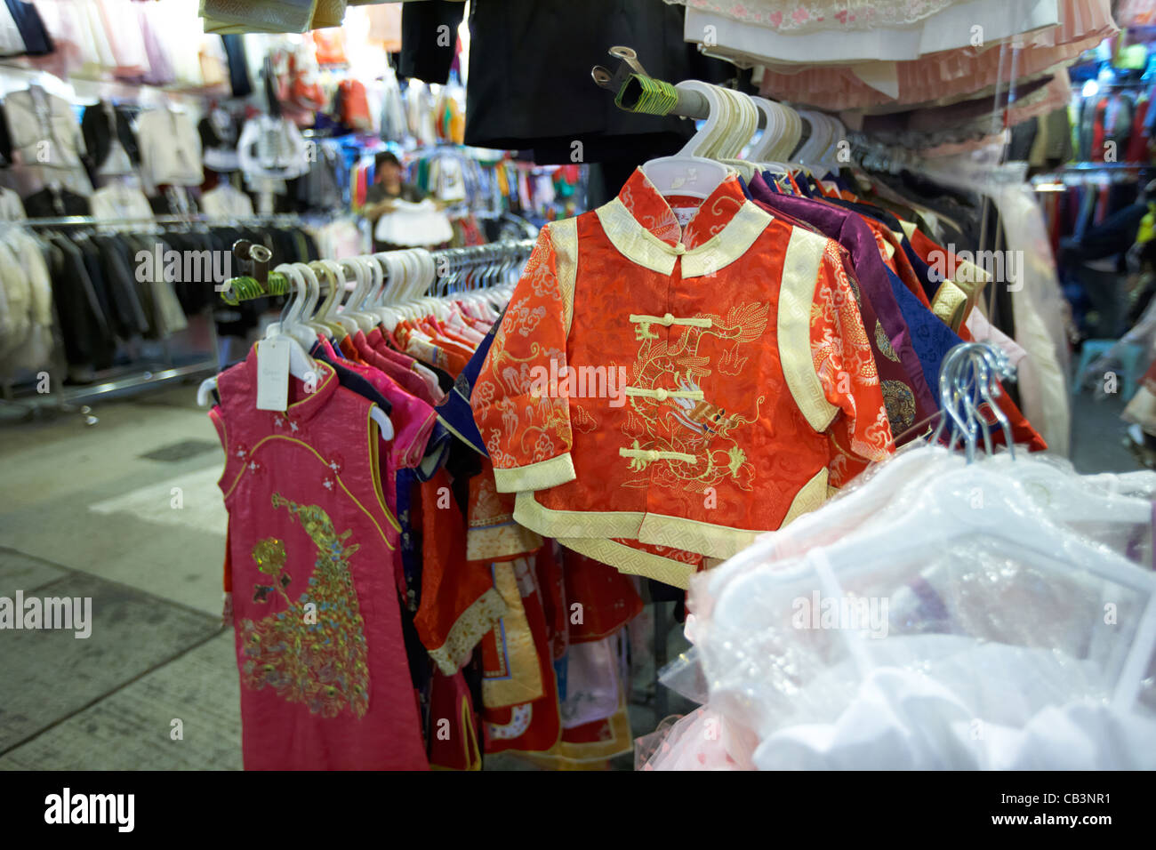 chinese style childrens clothing for sale at bowring street night clothes market tsim sha tsui kowloon hong kong - Stock Image