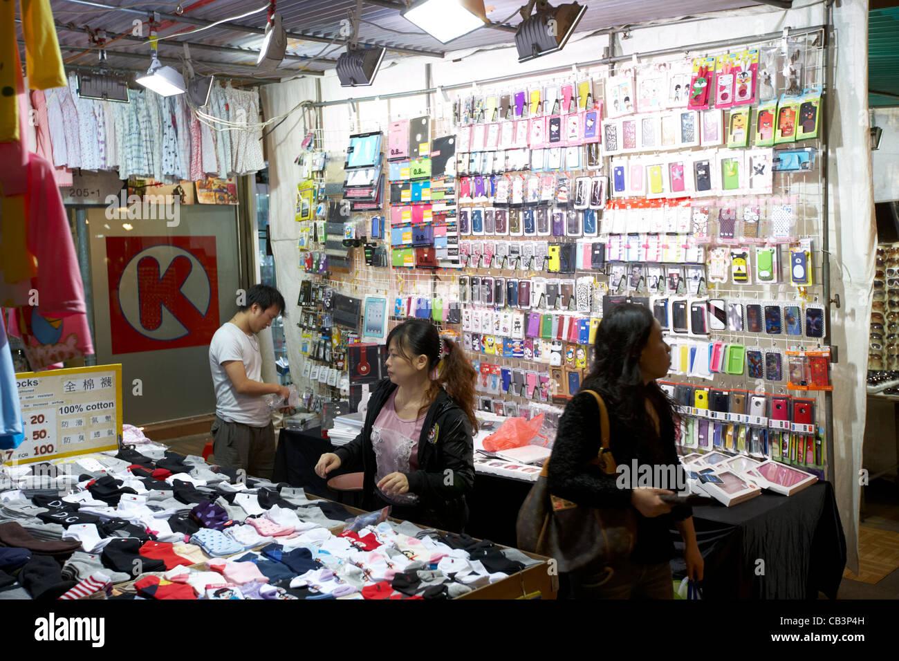 mobile phone and clothes accessory stand at temple street night market tsim sha tsui kowloon hong kong hksar china - Stock Image