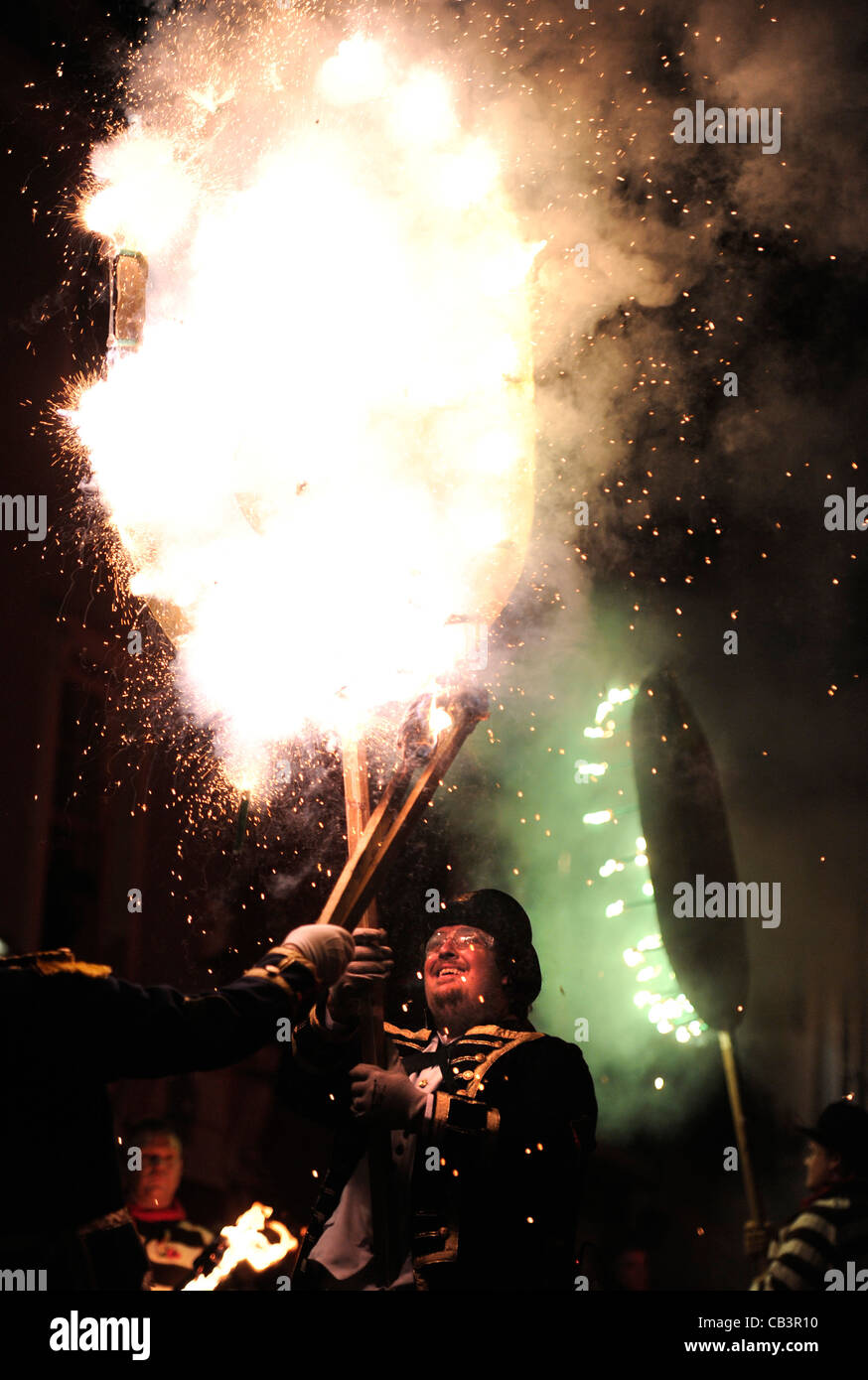 Remembrance poppy lit during Lewes Bonfire Night Celebrations. - Stock Image