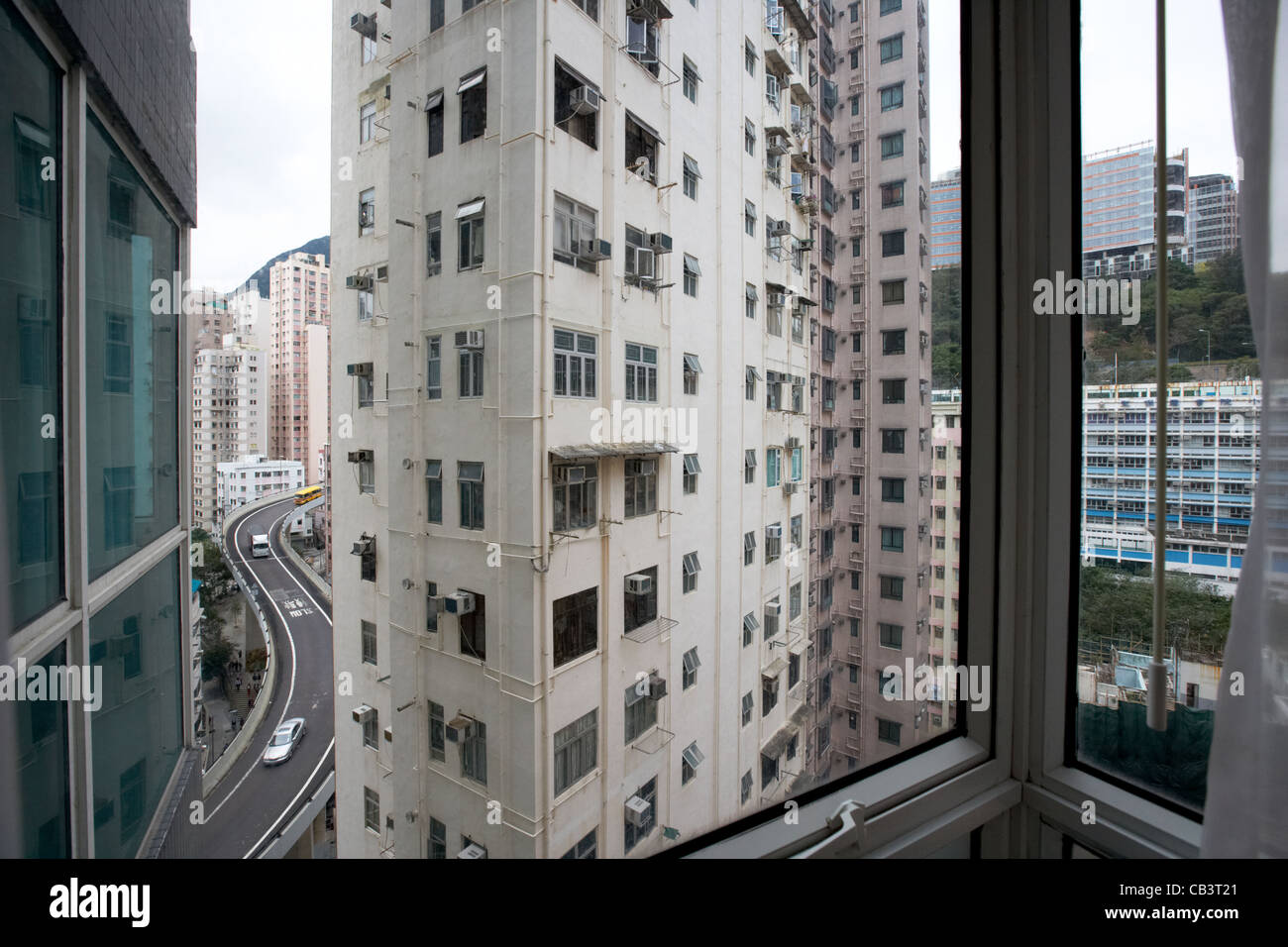 looking out from hotel window at high rise close proximity housing apartments hong kong island hksar china - Stock Image