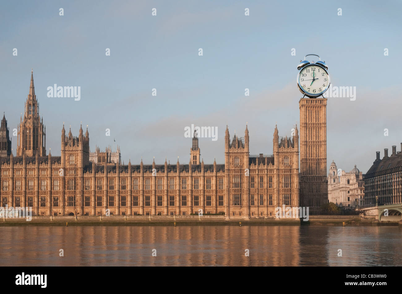 The Houses of Parliament in the United Kingdom, with an alarm clock instead of Big Ben - Stock Image