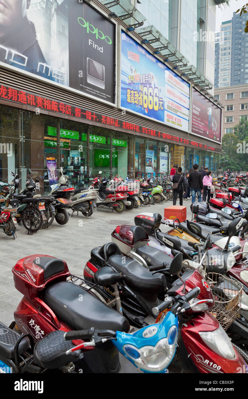 Lots of motorbikes and mopeds parked in Chengdu city centre center Sichuan province PRC, People's Republic of - Stock Image
