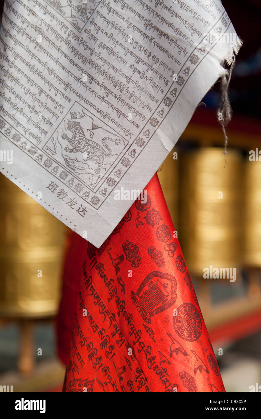 buddhist prayer flags and wheels Chengdu PRC, People's Republic of China, Asia - Stock Image