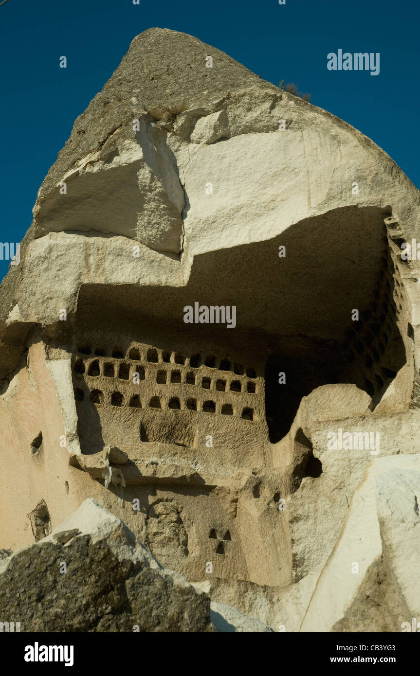 Pigeon holes carved into Cappadocia's soft tufa rock, these in the Open Air museum near Goreme - Stock Image