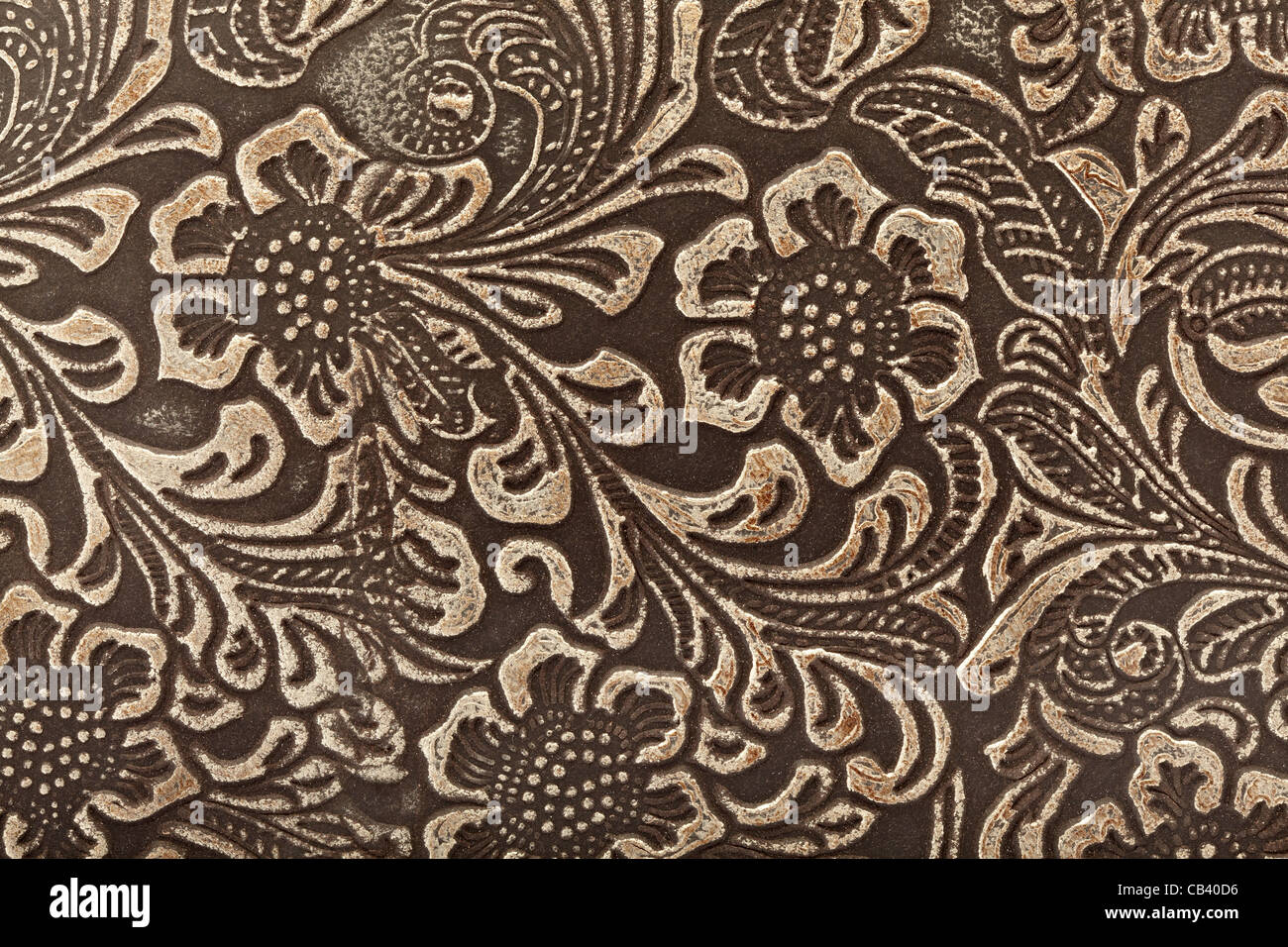 Embossed leather floral pattern background - Stock Image