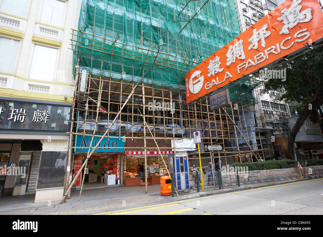 building covered with bamboo scaffolding tsim sha tsui kowloon hong kong hksar china - Stock Image