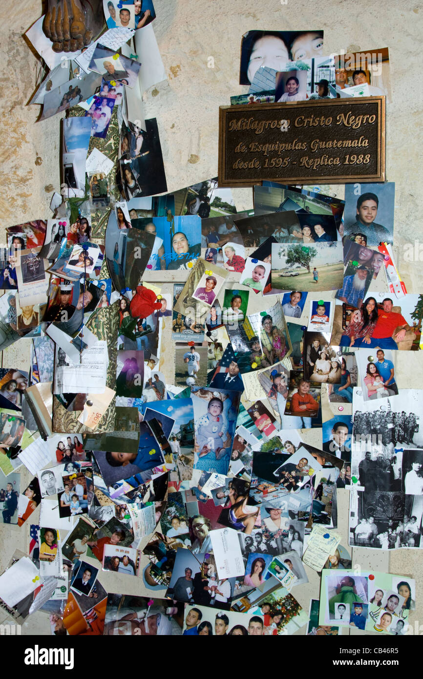 Display of Photographs Under Black Crucifix For Miracles San Antonio Texas - Stock Image