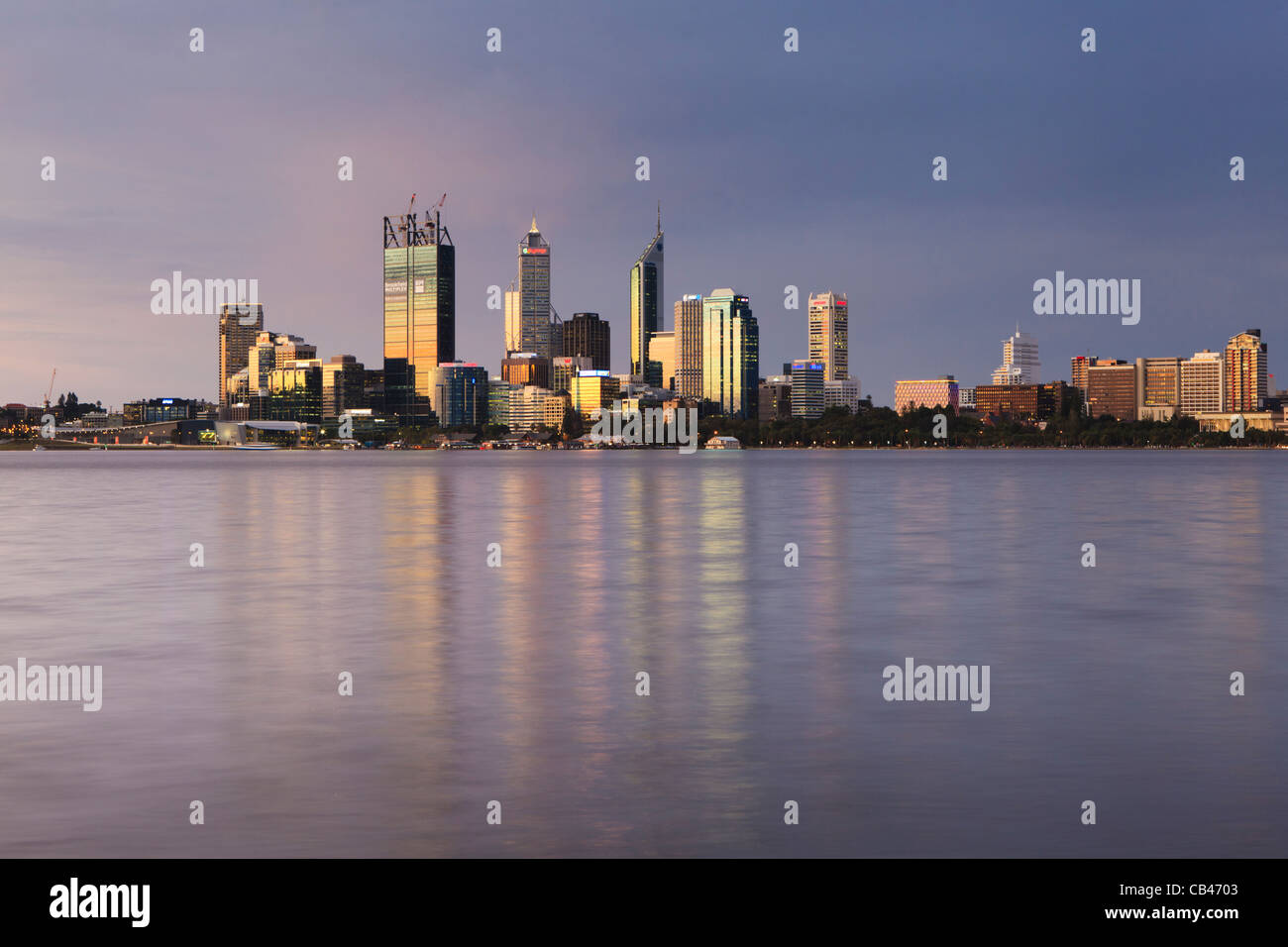 Perth cbd reflected in the Swan River at sunset. Perth, Western Australia - Stock Image
