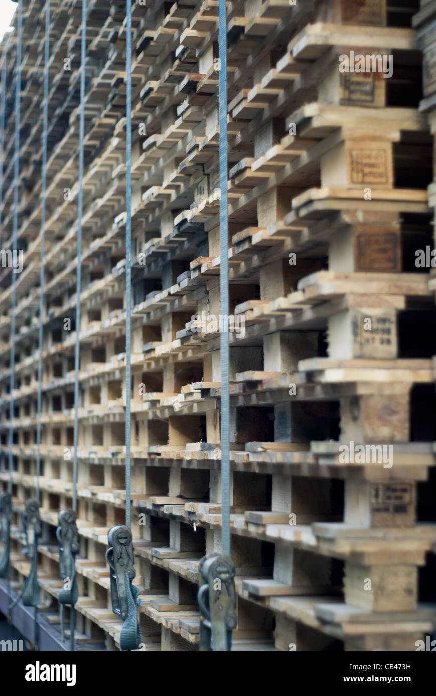 Stacked Pallets or Skids. Vanishing Point. - Stock Image