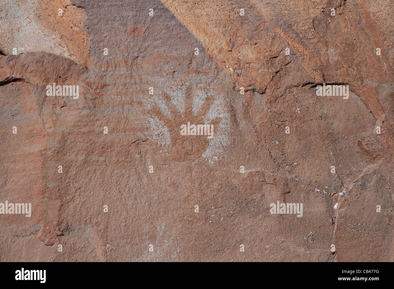 pictograph of hand on red sandstone cliff - Stock Image