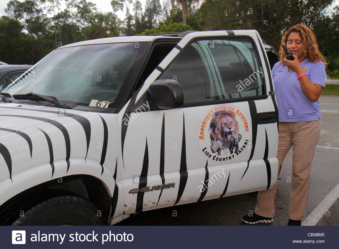 West Palm Beach Florida Loxahatchee Lion Country Safari drive-through wild animals Hispanic woman employee job two - Stock Image