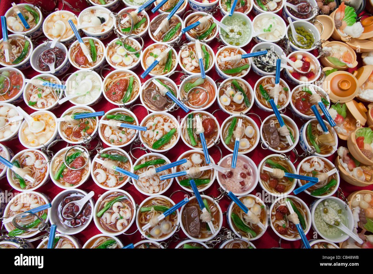 China, Hong Kong, Stanley Market, Souvenir Keyrings of Chinese Bowls of Food - Stock Image