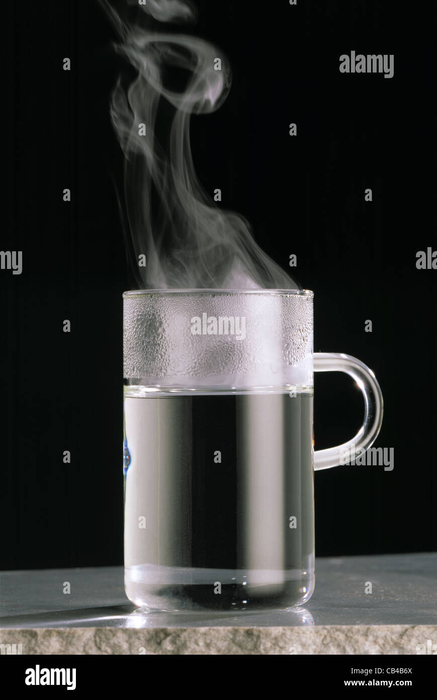 Hot In Water : Still tea glas with steamed hot water stock photo