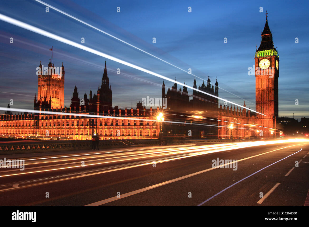Westminster Bridge, traffic trails, Big Ben and the Houses of Parliament, London, England, UK - Stock Image