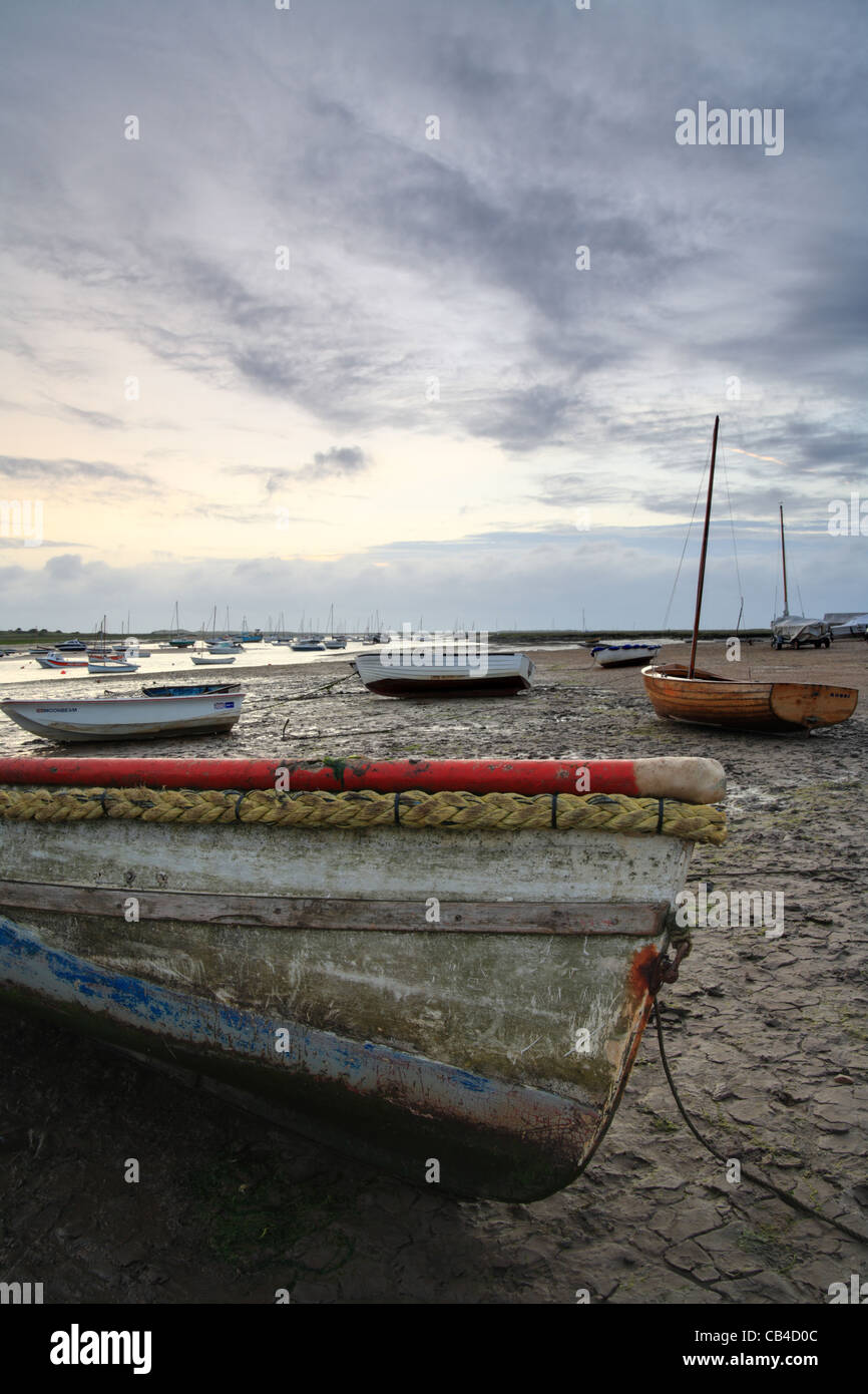 Brancaster Staithe Norfolk Coast East Anglia, boats stuck in the mud - Stock Image