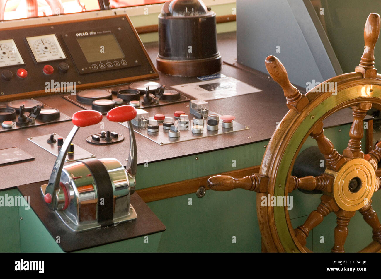 wheel house boat ship ships boats throttle throttles cabin skippers skipper - Stock Image