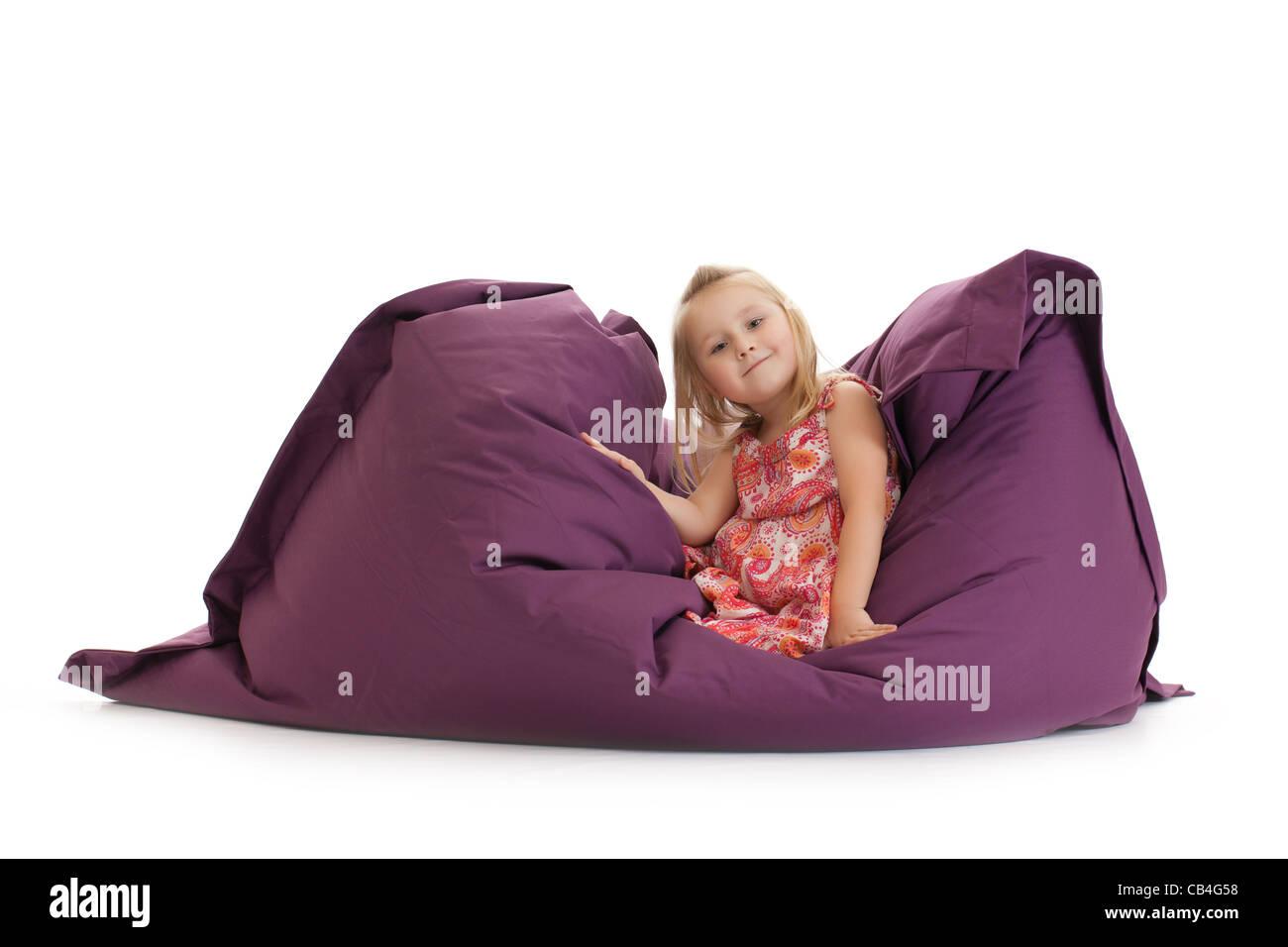 the little girl posing on beanbag - Stock Image