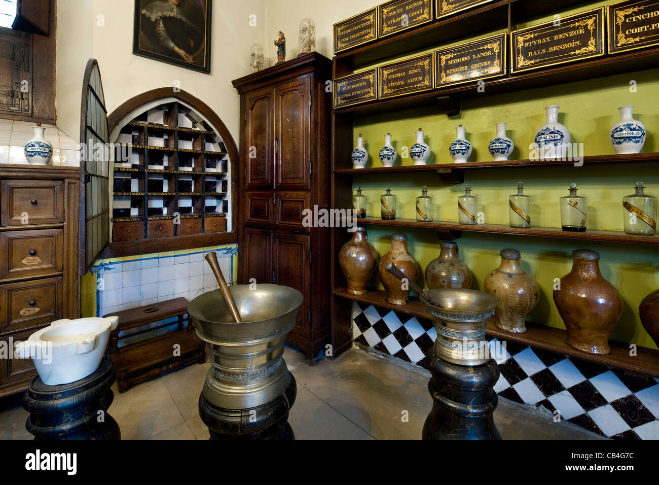 Jars and pitchers on shelves in pharmacy in the old Saint John's Hospital museum in Bruges, Belgium - Stock Image