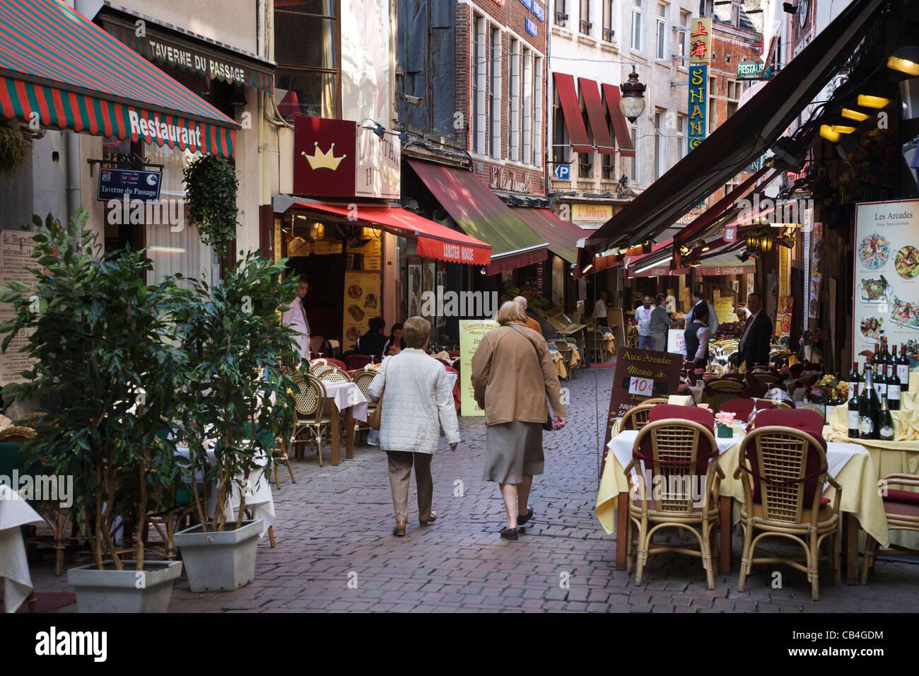 Restaurants in the Rue des Bouchers / Beenhouwersstraat / Butcher's street in Brussels, Belgium - Stock Image