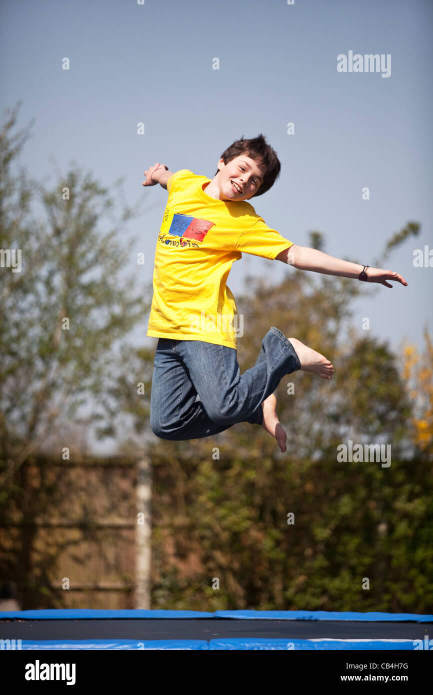 Leaping boy on trampoline Stock Photo