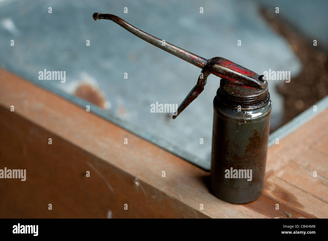 Old fashioned oil can with a trigger and spout - Stock Image