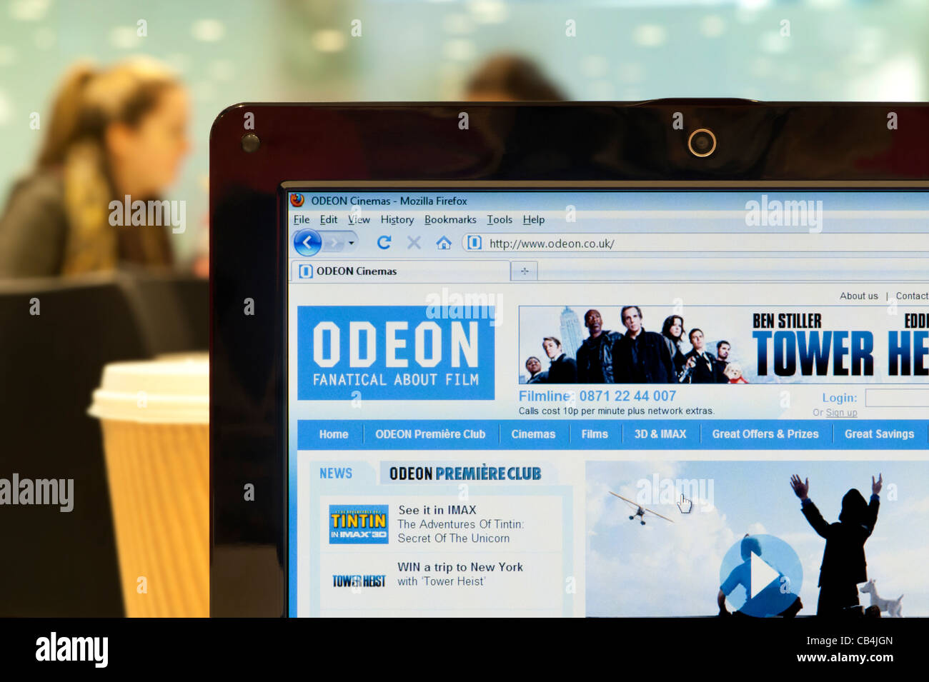 The Odeon website shot in a coffee shop environment (Editorial use only: print, TV, e-book and editorial website). - Stock Image