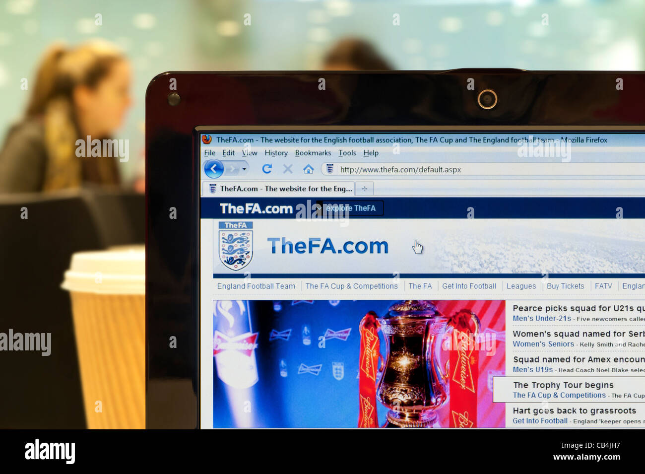 The FA website shot in a coffee shop environment (Editorial use only: print, TV, e-book and editorial website). - Stock Image