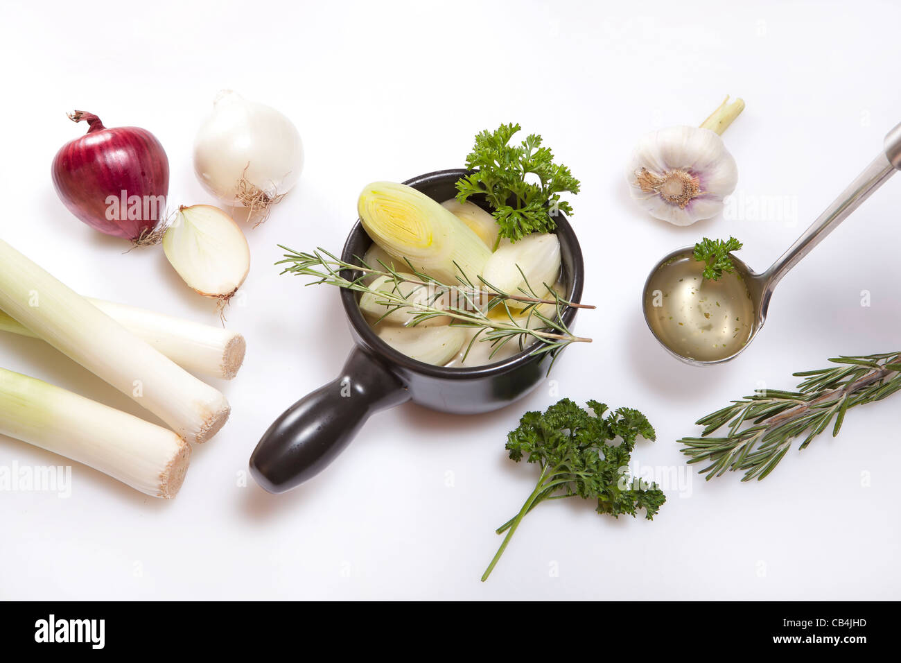 Ingredients for cooking a fresh leek and onion soup  - Stock Image