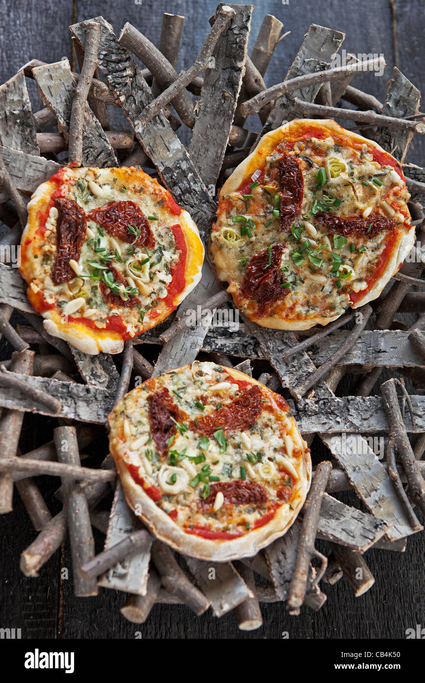 Pizza topped with cottage cheese and Gartenkraeuter  - Stock Image