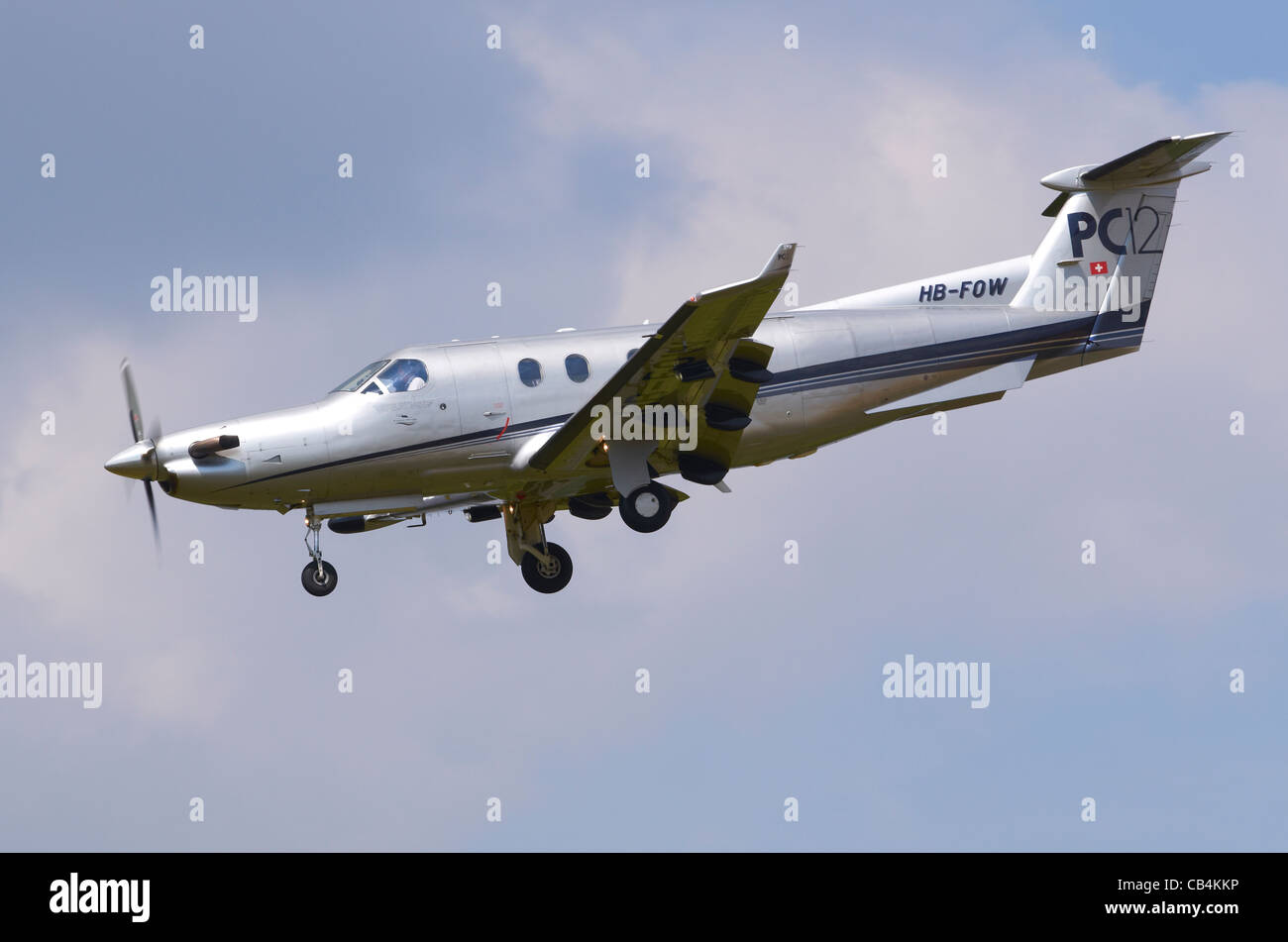 Pilatus PC-12 on approach for landing at RAF Fairford, UK - Stock Image