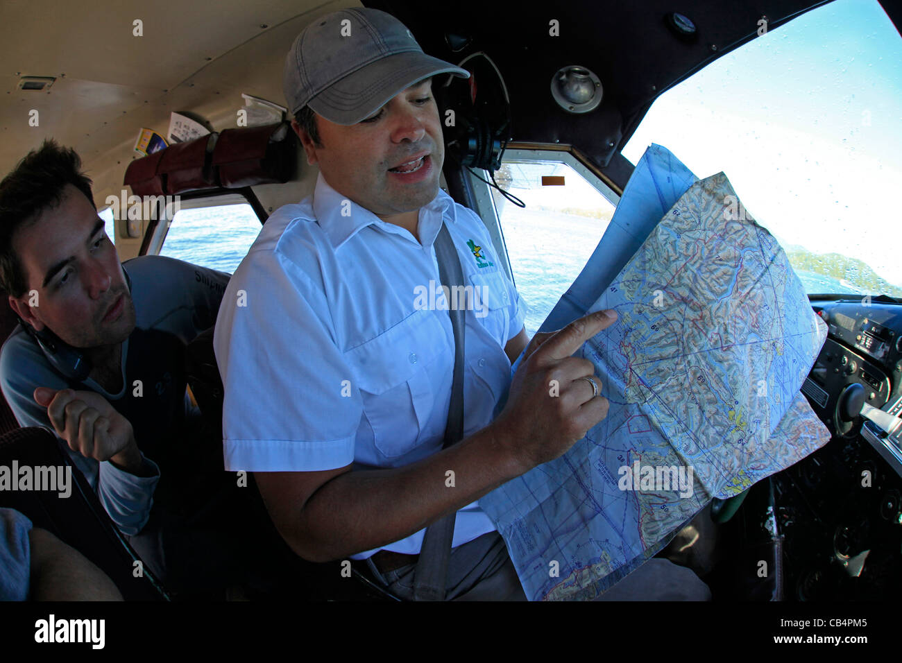 A floatplane pilot explains the scenic route to be taken at Vancouver Island - Stock Image