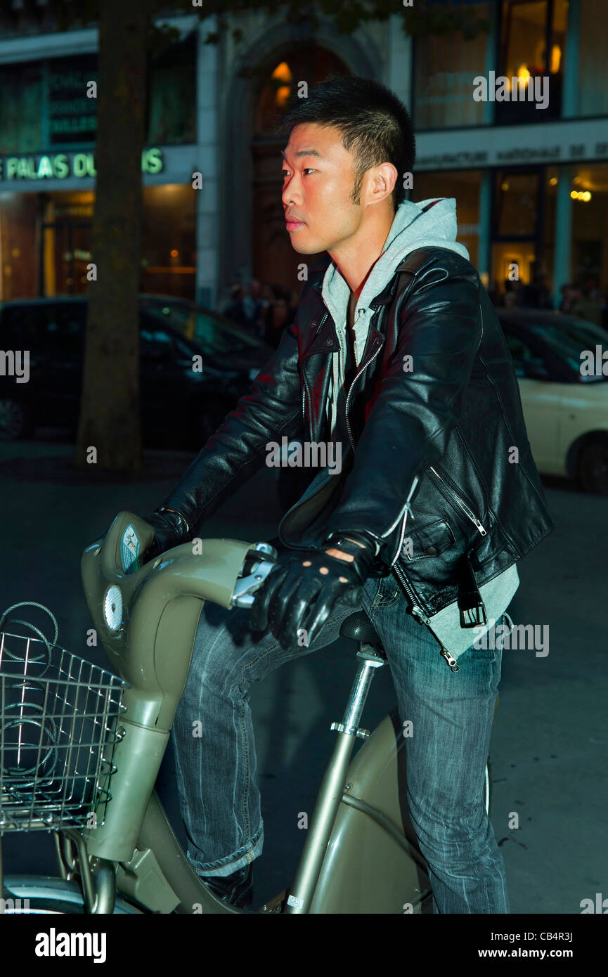 Paris, France, Young Chinese Man on Velib Bicycle, Cycling at Night Stock Photo