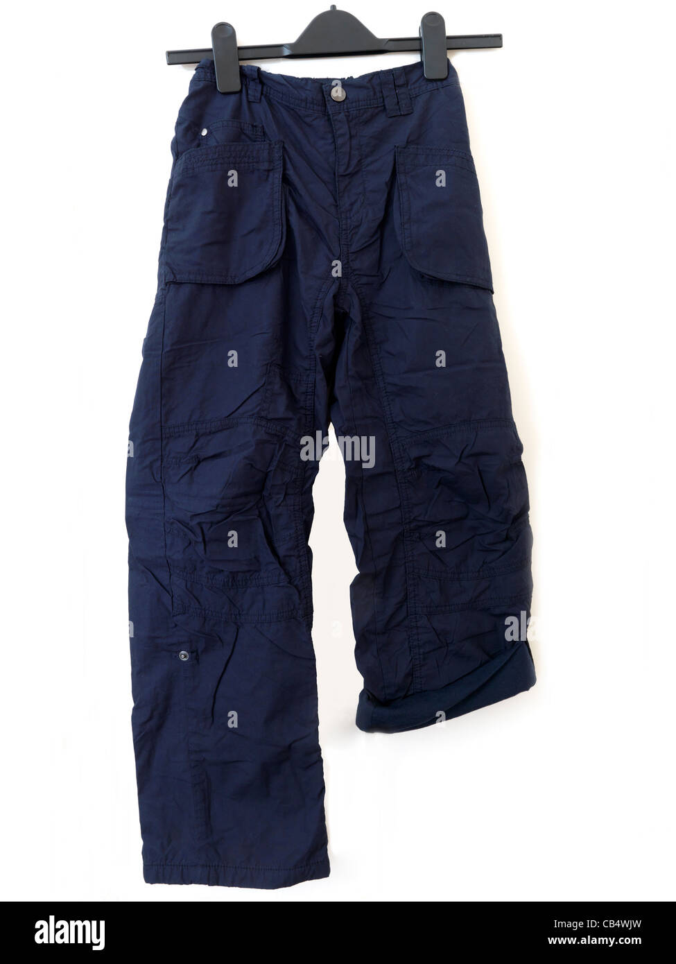 A Pair Of Boy's Cargo Trousers With One Leg Buttoned Up - Stock Image