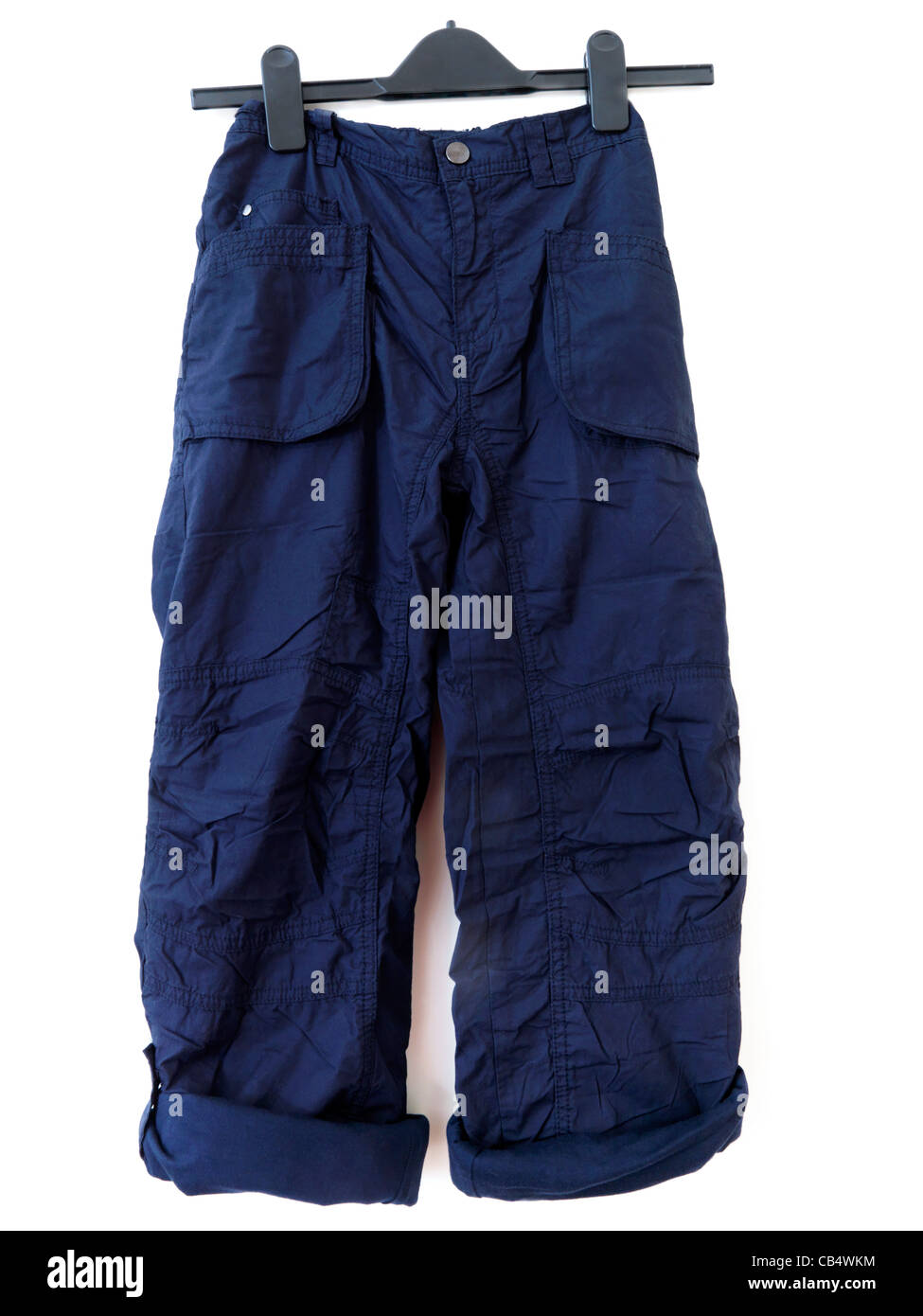 Pair Of Boy's Cargo Trousers With Both Legs Buttoned Up - Stock Image