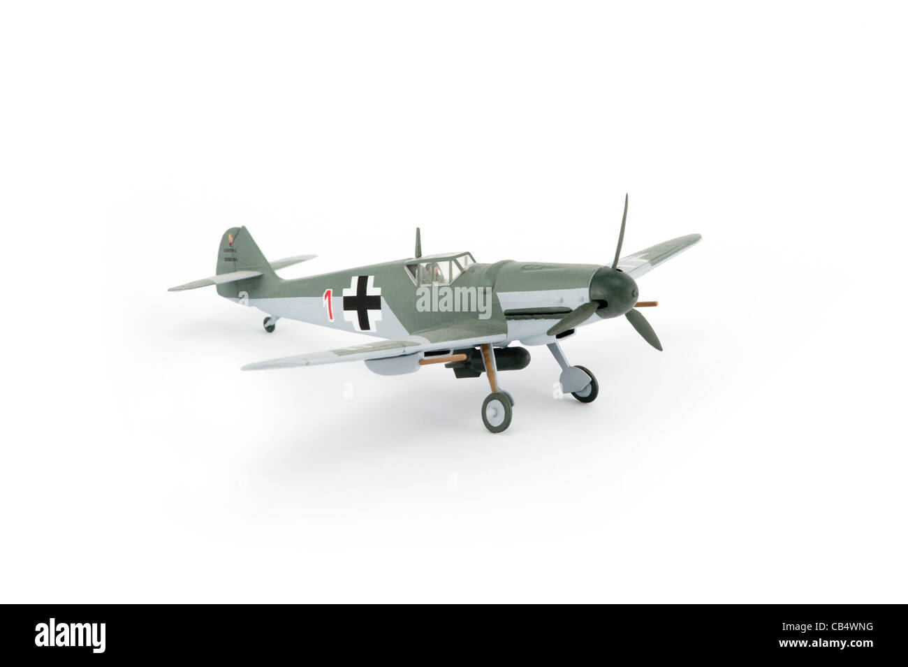 A scale model of a Messerschmitt Bf 109 shot as a cut-out against a white studio background. - Stock Image