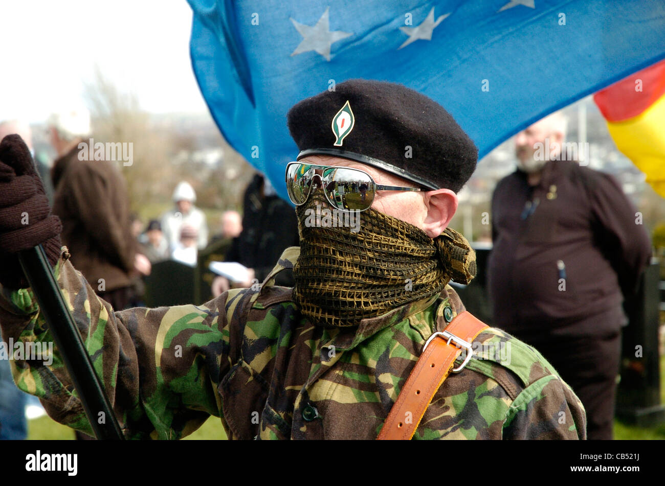 Member of the Real IRA attending 1916 Easter Rising commemoration in Londonderry, Northern Ireland. - Stock Image