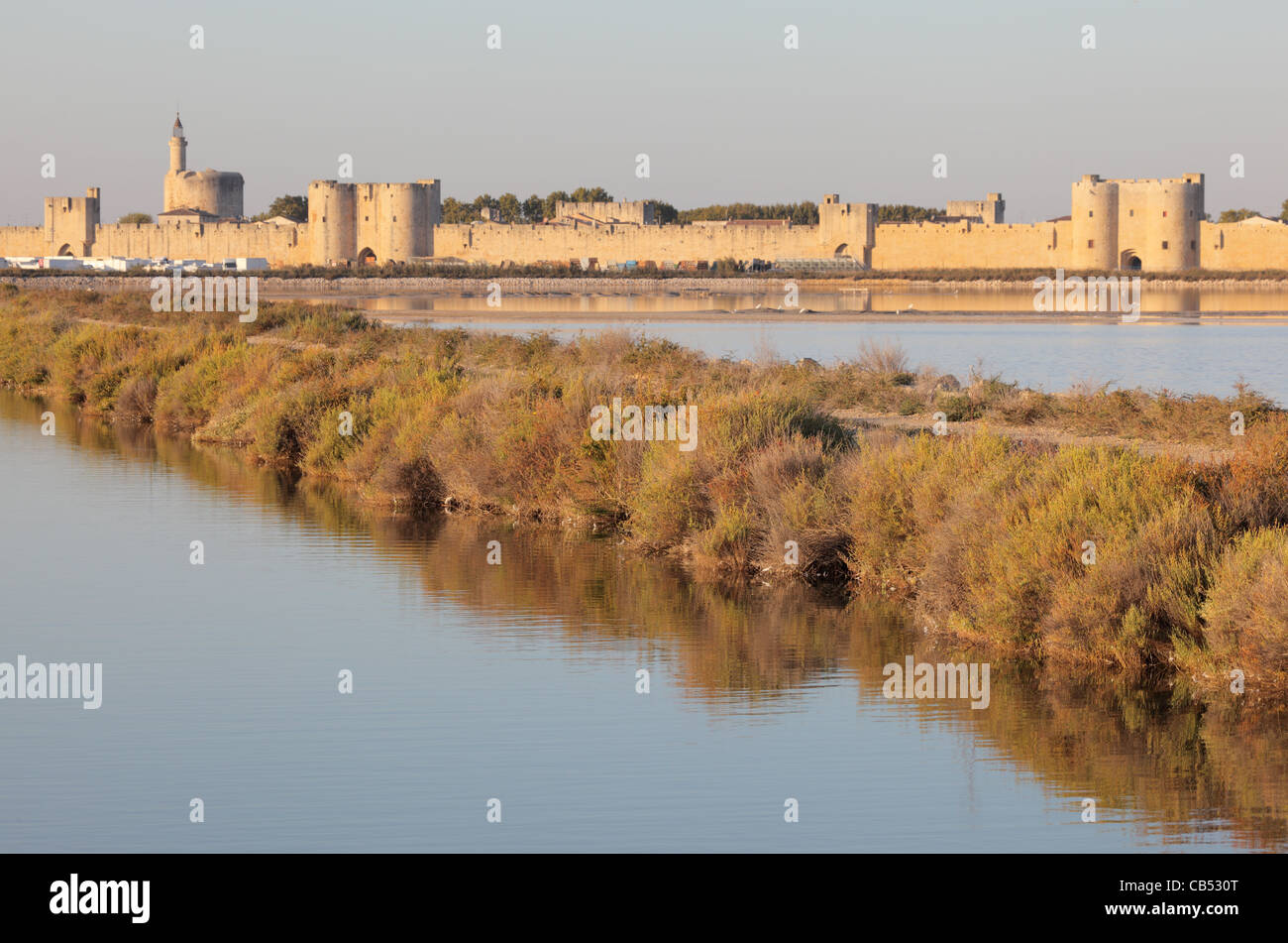Medieval town Aigues-Mortes between swamps of the Camargue, France - Stock Image