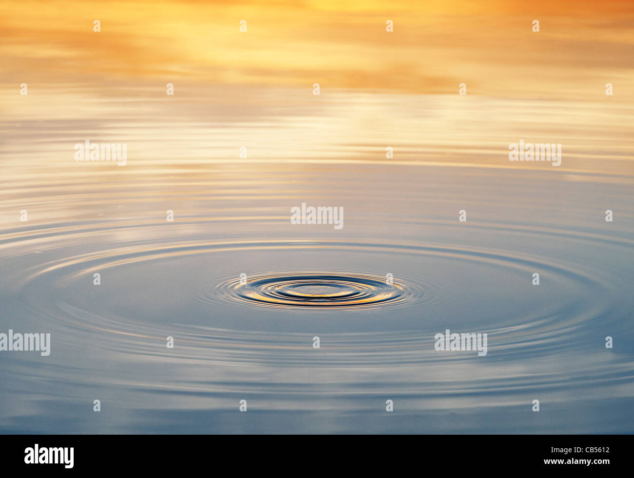 Golden water ripple at sunrise in India - Stock Image
