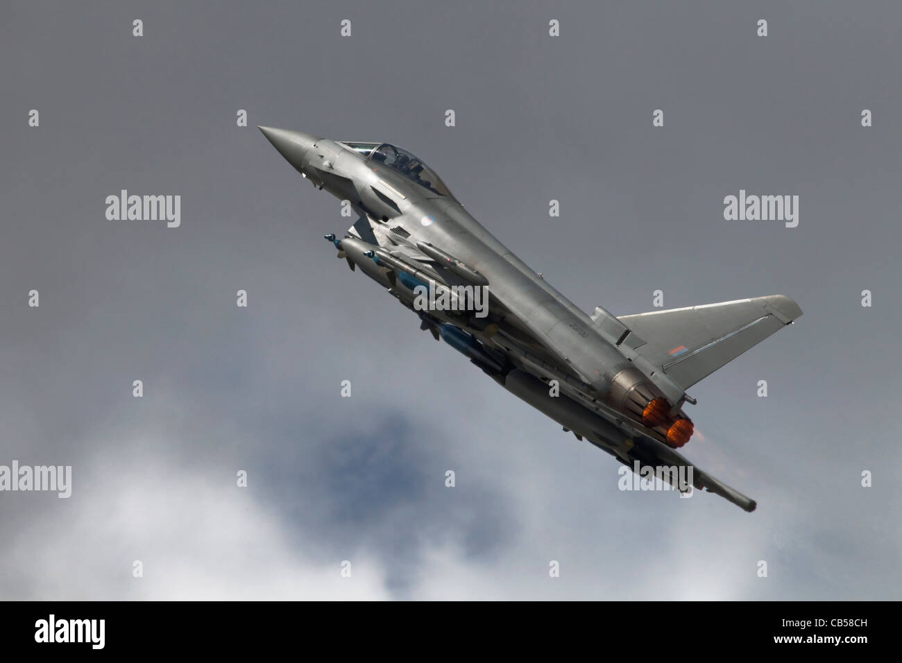 A Bae Systems Typhoon fighter of the RAF climbing away in to dark skies - Stock Image